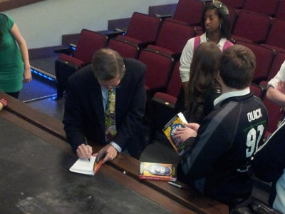 Brendan signing books at Marist