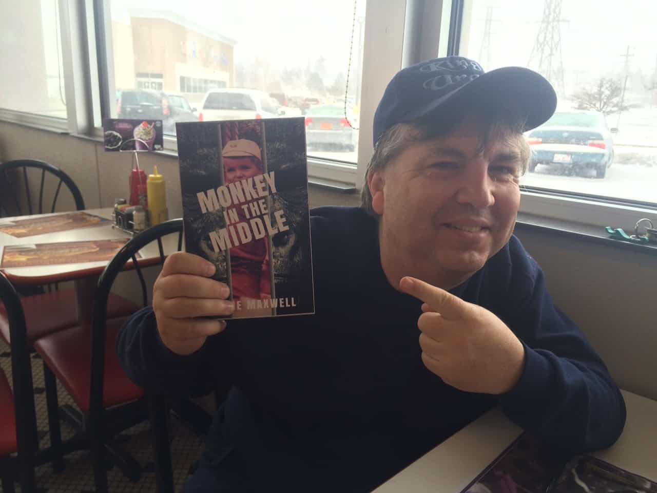 """Milwaukee Journal Reviews """"Monkey in the Middle"""" by Dobie Maxwell"""
